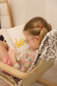 Young girl reading in a chair