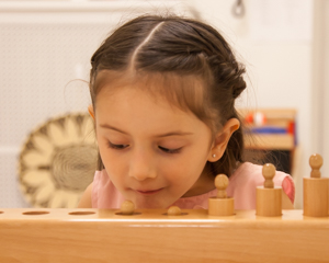 Young girl playing with a toy
