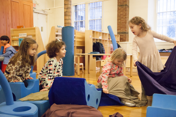 Young girls playing with gymnastics equipment