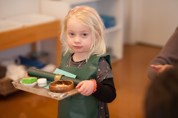 Young girl holding a tray