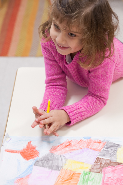 Young girl drawing a picture