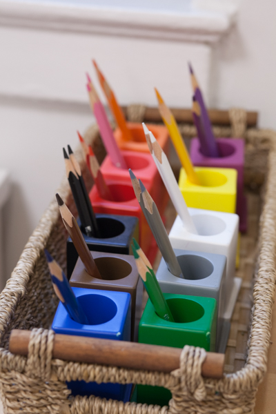Colored pencils in a basket
